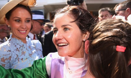 Michelle Payne celebrates her winning ride with her sisters at Flemington racecourse in Melbourne on Tuesday.