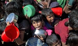 Rohingya Muslim children wait to receive food at Thaingkhali refugee camp in Ukhiya, Bangladesh.