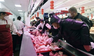 People wearing masks buy meat at a supermarket in Hangzhou in east China's Zhejiang province in February. China has banned exports of meat from four Australian abattoirs.