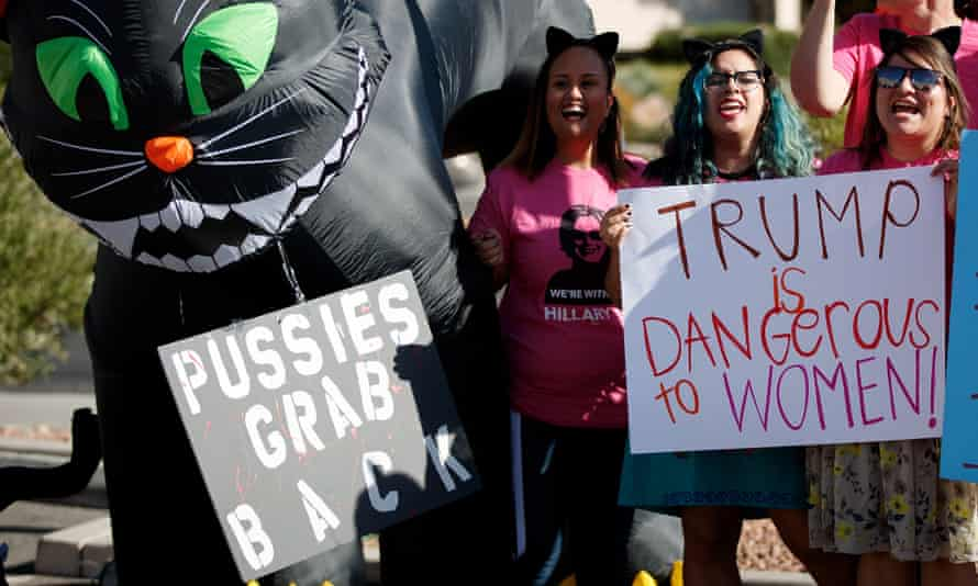 Activists and volunteers from Planned Parenthood rally against Donald Trump, 18 October 2016.