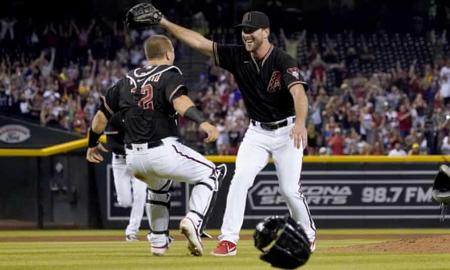 Tyler Gilbert, right, celebrates after his no-hitter against the Padres with catcher Daulton Varsho.