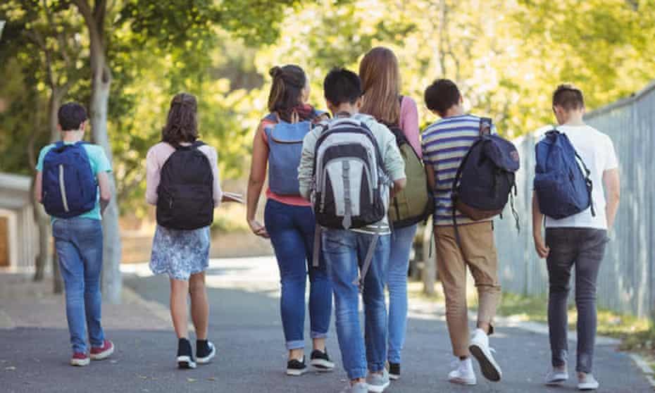Teenagers walking along path