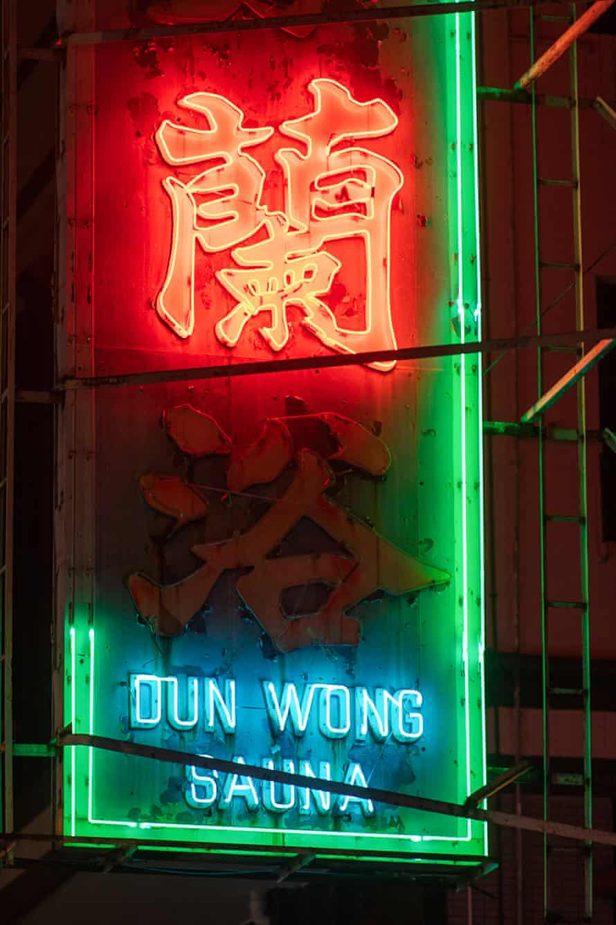 Neon signs used to combine red-coloured Chinese characters with a green pattern