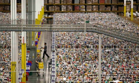 Workers gather items for delivery at Amazon's distribution centre in Phoenix, Arizona. The US store, which sells about 500m items compared with 4m on the global store, will be blocked in Australia