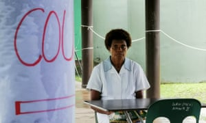 A nurse sits at a screening station for anyone presenting with a cough or flu like symptoms at Warangoin Clinic in East New Britain province, Papua New Guinea