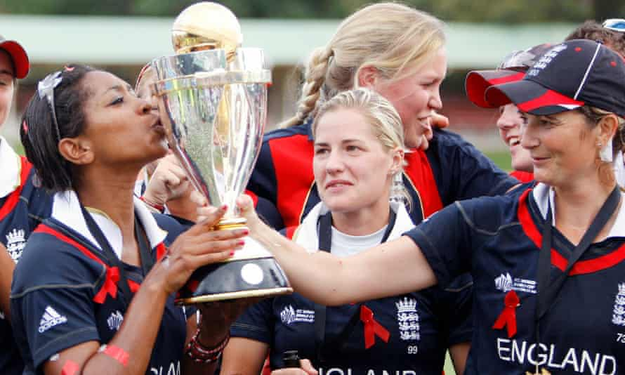 Ebony-Jewel Rainford-Brent, left, kisses the World Cup trophy held by the England captain, Charlotte Edwards, in 2009.
