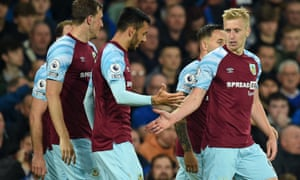 Burnley's English defender Ben Mee (R) celebrates with teammates.