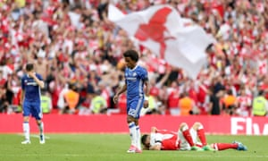 Chelsea's Willian (centre) looks dejected after the final whistle