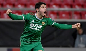 Pedro Neto of Wolves roars with delight after scoring his team's equaliser in their behind-closed-doors Europa League tie at Olympiakos.