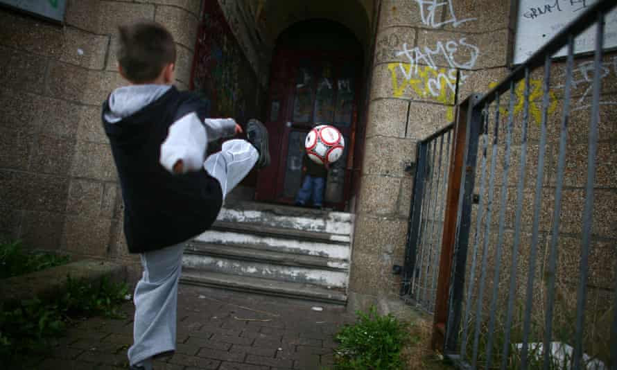 Children play in a rundown street