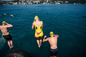Istanbul, Turkey: Swimmers jump in the river as they take part in the Bosphorus Cross Continental Swim event