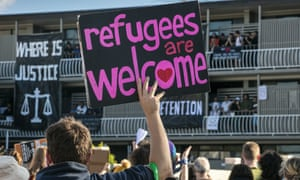 Protesters gather on Sunday to support refugees and asylum seekers detained at the Kangaroo Point Central Hotel & Apartments in Brisbane