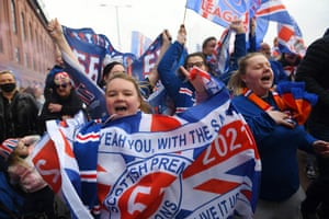Rangers fans celebrate outside Ibrox Stadium, home of Rangers Football Club after securing their first Scottish Premiership title for 10 years