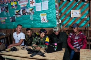 Guerrilla fighters watch a movie on a laptop