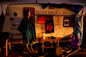 Guinevere lighting candles outside her caravan - a traditional traveller custom - at the peace camp set up by anti-fracking campaigners at Barton Moss, Salford where iGas are drilling to determine if the area is commercially viable for shale gas tracking