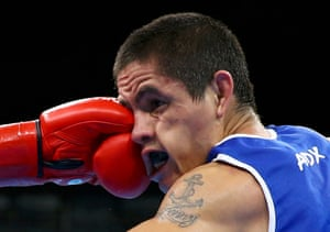 Ignacio Perrin of Argentina competes in the preliminary men's light boxing (60kg) round of 32.