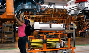 A General Motors factory in Detroit. The US has agreed to allow the overseas element of automotive components to increase.