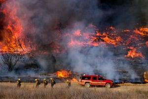 Irwindle, California Firefighters battle brush fire burning in the Santa Fe Dam Recreation Area