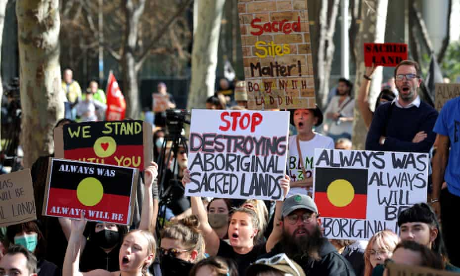 People protest outside the Rio Tinto office in Perth last June over the company's blasting of the Juukan Gorge in the Pilbara, destroying ancient rock shelters.