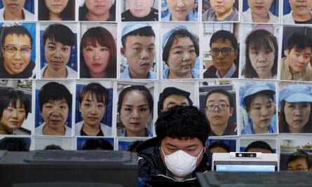 an engineer in beijing works on facial recognition software to identify people when they wear face masks in march this year.