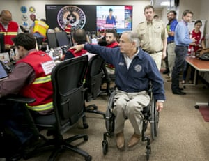 Governor Greg Abbott, front right, offers support to emergency officials at the State Operations Center in Austin, Texas,, Texas, on Friday Aug. 25, 2017, in preparation for Hurricane Harvey. (Jay Janner/Austin American-Statesman via AP)