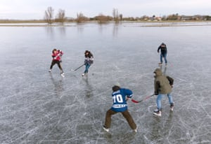 Ely, UKPeople play ice hockey on frozen flooded fields in Cambridgeshire, as the cold snap continues to grip much of the nation. The Cambridgeshire Fens were the birthplace of British speed skating and require four nights of frost, with a temperature of -4 or colder and little or no thawing during the days in between, to make ice strong enough to skate on