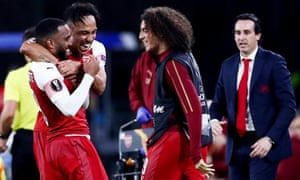 Alexandre Lacazette of Arsenal is congratulated by his teammates.