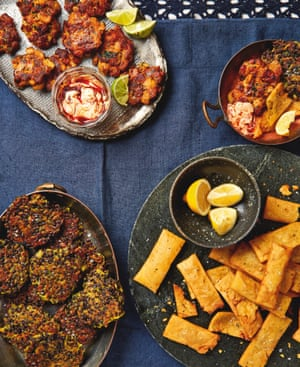 Yotam Ottolenghi's party finger food (clockwise from top): Chorizo, banana and prawn cakes with harissa yoghurt, (mixture of all 3), Panelle (on marble), Courgette, lentil and turmeric fritters.