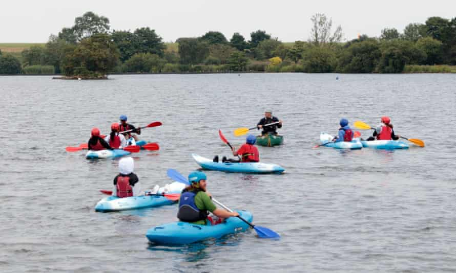 People enjoying canoeing and kayaking lessons at the Leeds Sailing and Activity Centre, Yeadon Tarn, Leeds