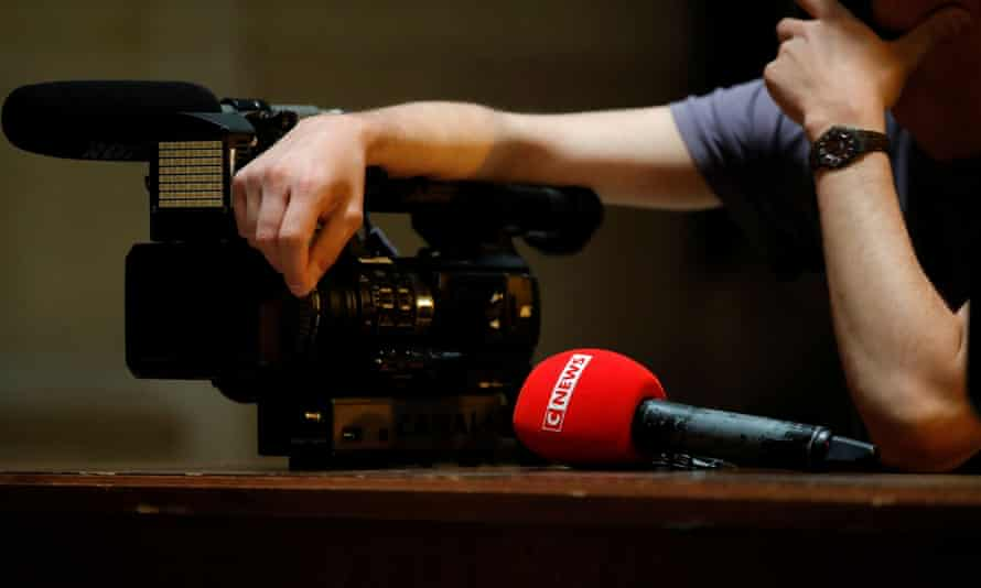 The logo of CNEWS is seen on a microphone at Paris courthouse