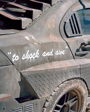 Side panel of an attendee's car referencing the LAPD's famous motto.