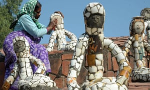 A worker cleans sculptures in Nek Chand's Rock Garden of Chandigarh.