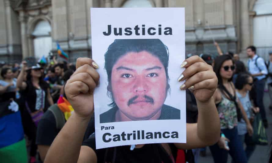 A demonstrator holds a banner picturing a portrait of late Mapuche community member Camilo Catrillanca on the first anniversary of his murder, in Santiago, Chile.
