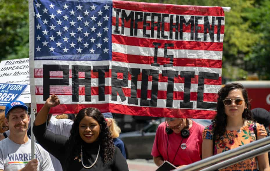 Activists call for the impeachment of Donald Trump in New York City, on 15 June.