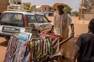 A hawker selling goods in Niamey