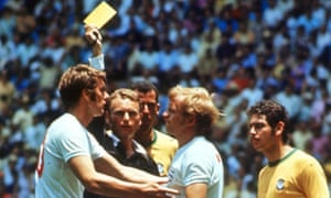 1970 World Cup Finals Guadalajara, Mexico 7th June, 1970. England 0 v Brazil 1. England 's Francis lee is booked by the referee for fouling Brazilian goalkeeper Felix, who lays on the ground injured.<br>1970 World Cup Finals, Guadalajara, Mexico 7th June, 1970, England 0 v Brazil 1, England 's Francis lee is booked by referee Abraham Klein for fouling Brazilian goalkeeper Felix, who lays on the ground injured  (Photo by Rolls Press/Popperfoto/Getty Images)