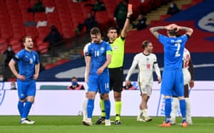 Iceland's Birkir Saevarsson (right) is shown a red card after committing a second bookable offence.