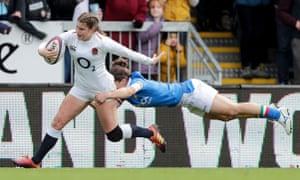Jess Breach powers through an Italy tackle towards the tryline.