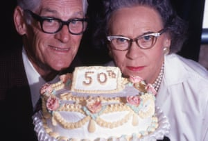 A man and a woman with a 50th wedding anniversary cake