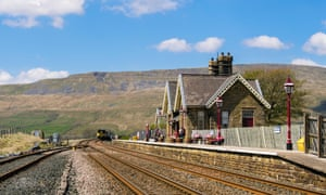 A train approaching Ribblehead station on the Settle-Carlisle line.