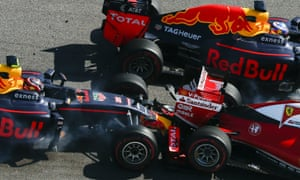 The Ferrari driver Sebastian Vettel is shunted by Kvyat while Daniel Ricciardo, top, takes evasive action.