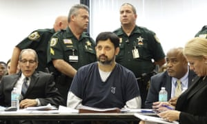 Nouman Raja sits with his defense team after he was sentenced to 25 years in prison 25 April 2019 in West Palm Beach, Florida.
