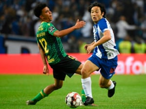 Gustavo Assunção (left), in action here against Porto, is one of three Atlético Madrid players on loan at Famalicão.