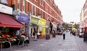Pavement cafes and shops just off Balham High Road in South London