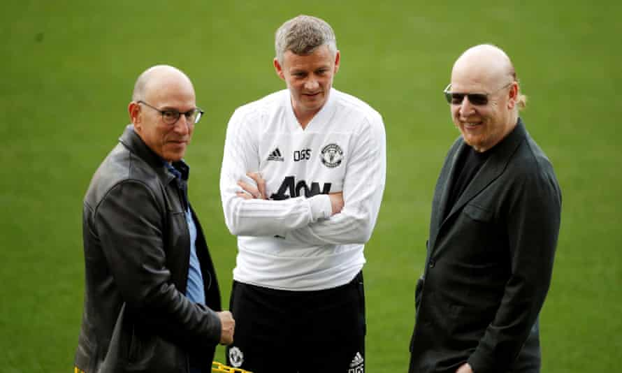 Manchester United's manager Ole Gunnar Solskjær with the co-owners Joel Glazer and Avram Glazer in 2019.