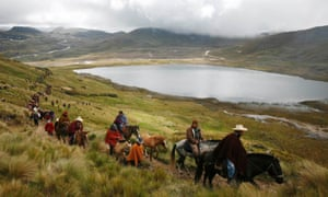 Andean people marching in protest against a mining project at Perol lake in Peru's Cajamarca region.