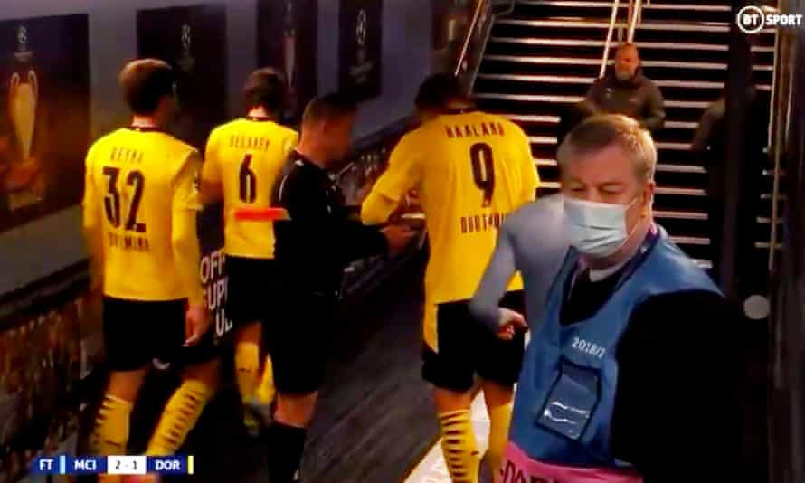 Erling Haaland signs for the Romanian assistant referee Octavian Sovre after Borussia Dortmund's game at Manchester City on Tuesday.
