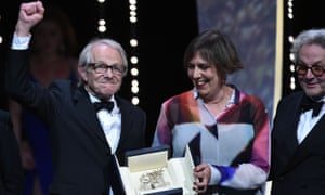 Ken       Loach with his producer Rebecca O'Brien and jury president George       Miller as I, Daniel Blake wins in Cannes.
