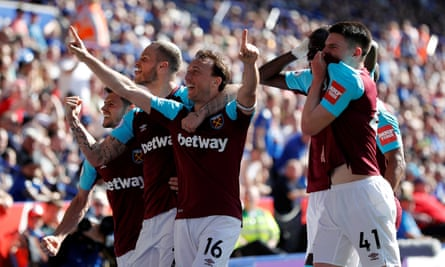 West Ham's Mark Noble celebrates scoring their second goal against Leicester with team mates.