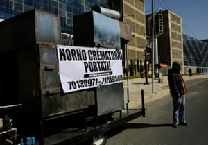 A prototype of a mobile crematorium in La Paz with a banner reading 'Mobile crematorium, Made in Bolivia', built by a local engineer to alleviate the backlog of bodies at local crematoriums.
